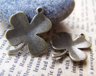 10 pcs of Antique Bronze Lucky Flower Charms 20x24mm A436