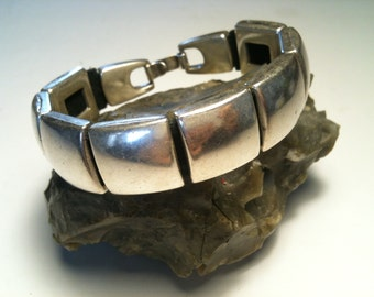 Leather Bracelet with leather sliders.