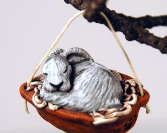 sleeping white rabbit ornament