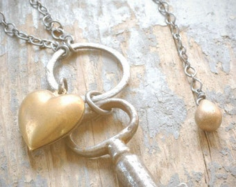 dainty brass heart keychain necklace. antique cabinet key and vintage puffed brass heart on oxidized sterling silver by val b.