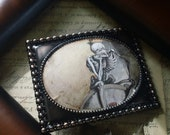 The Weight of World Overlords- altered art Skeleton collage antiqued brass buckle