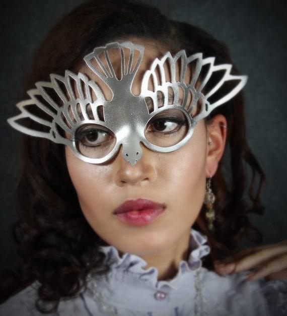 Bird mask in metallic silver leather