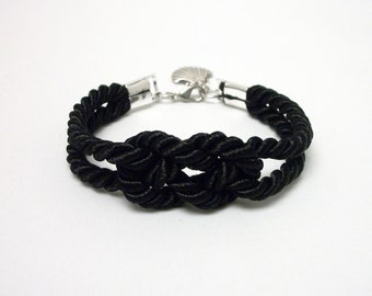 Black double infinity knot nautical rope bracelet with silver seashell charm