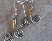Sterling silver double swirl wire earrings with 14k gold filled wire accent.