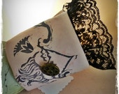 A French Cuff Edged in Black Lace