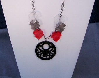 Necklace with Wood Pendant and Red, White, and Gray Leaves