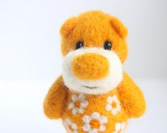 Orange felted pocket bear with flowers
