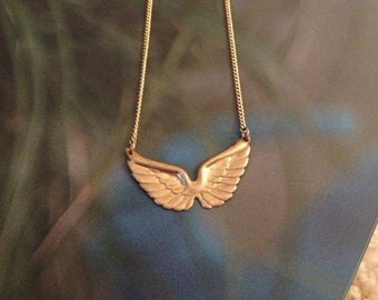 Wings of Desire Necklace Brass wings in flight on gold chain