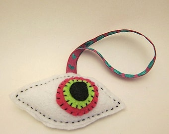 Weird christmas ornament hand sewn stuffed eye