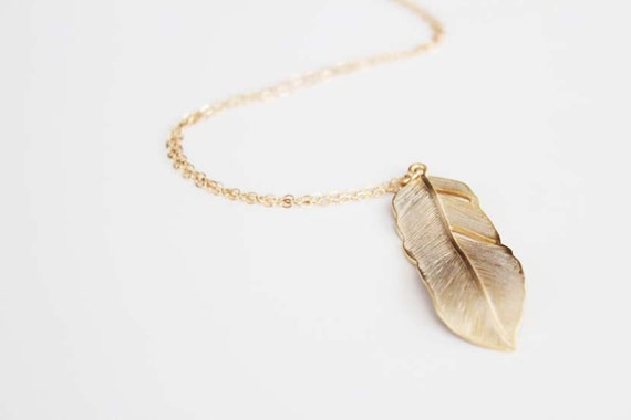 https://www.etsy.com/listing/104247208/long-feather-necklace-gold-flowing?ref=favs_view_4