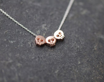 ROSE GOLD Trio Skull charms necklace on delicate silver chain, three skull necklace