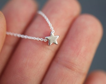 Matte silver Tiny star charm necklace on delicate sterling silver chain modern everyday minimal