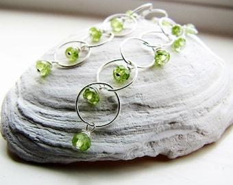 peridot earrings. sterling silver earrings. gemstone earrings. SIGNATURE. long dangle earrings. green earrings. natural stones. August Leo.