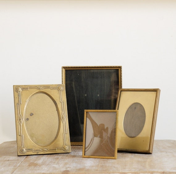 Vintage Set of four metal frames for photos made from metal and wood one bevelled oval