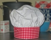 Child's red gingham chef hat fits ages 1 to 7.