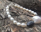 Freshwater Pearl and Onyx gemstone bracelet, with natural pear nugget