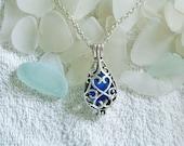 Sea glass locket necklace. Blue teardrop locket. Sea glass jewelry.