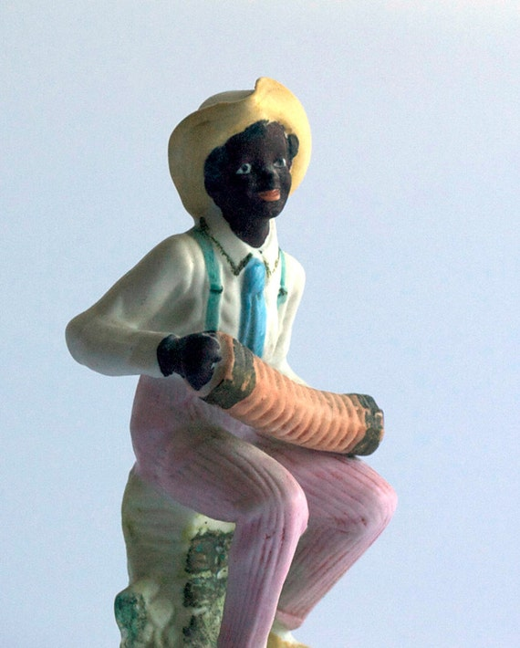 Black Musician Ceramic Figurine, you can almost hear the music from the concertina