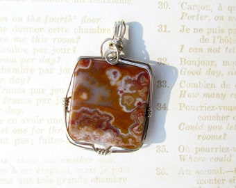 Sterling silver wrapped Mexican Lace stone