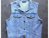 vintage 1980s classic denim vest in light wash. retro clothing.