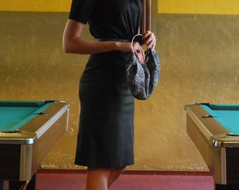 black, knee-length 40s dress with mace sleeves