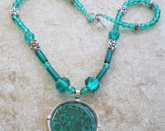 Teal pheasant pendant necklace with silver accents