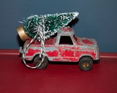 Vintage Chippy Red Pick Up Truck with Bottle Brush Tree