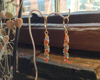 Drop earrings: orange, light olive and periwinkle beaded