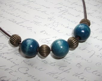 Chunky blue wood bead necklace with brass inserts