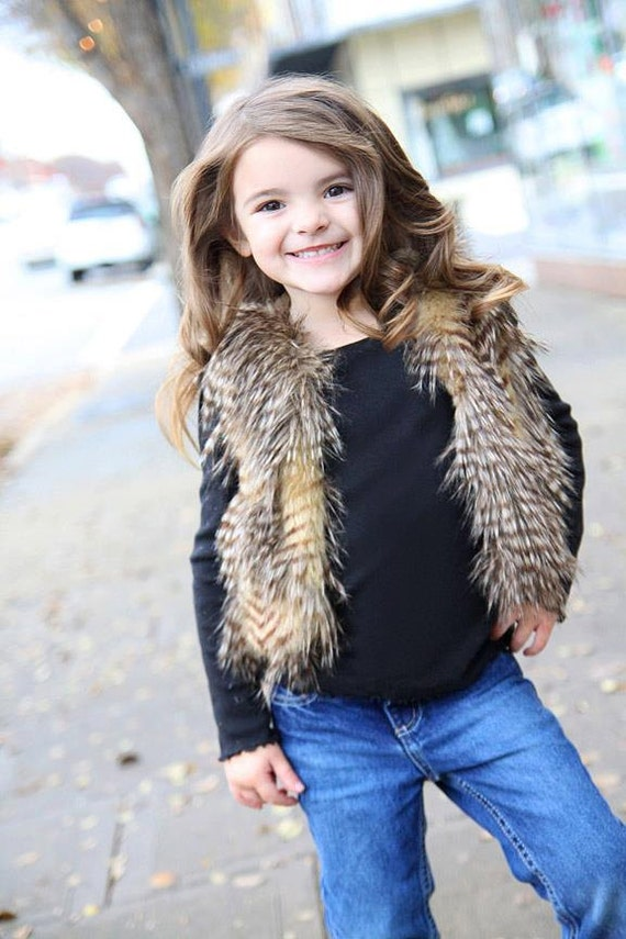 As cozy as it is cute, this reversible faux-fur vest is a perfect cold-weather layer. She can wear it with jeans, skirts, dresses, leggings pretty much everything in her closet!