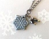 20% OFF SALE! Snowflake Pendant Necklace. Sky Blue. Ceramic. Glass Beads. Black Porcelain. Light Blue. Clay. Winter Jewelry. Gunmetal Chain