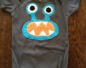 Turquoise Bernard the Monster sizes 3-6m, 6-12, 12-18