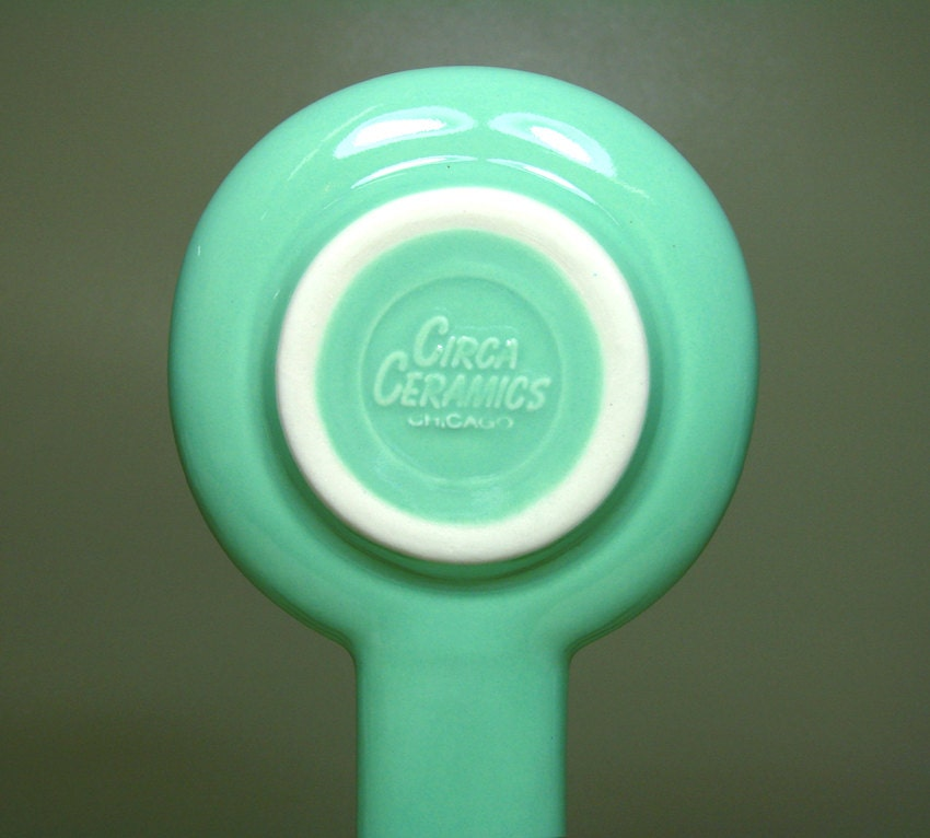 a spoon rest glazed in blue green with a black cat print, Made to Order / Pick Your Colour