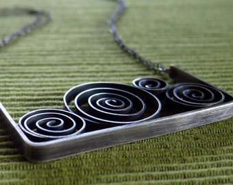 Spirals on a Swing- handmade, oxidized, sterling silver necklace with a bevy of spirals