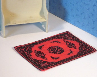 Small Miniature rug, hand embroidered black on red