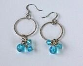 Handmade dangle hoop earrings with aqua blue bicone accents