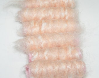 Imagine our identity crisis when she put us in a bright pink petticoat. Orange or pink, what's the difference? Fiber Bead, dread hair tube