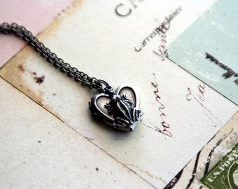 frog. heart locket necklace. silver ox