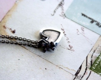bow. locket necklace. silver ox jewelry
