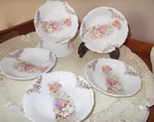 Victorian porcelain Butter pats pink yellow white flowers embossed details
