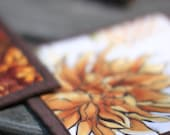 quilted pot holders - orange fall mum and fallen leaves