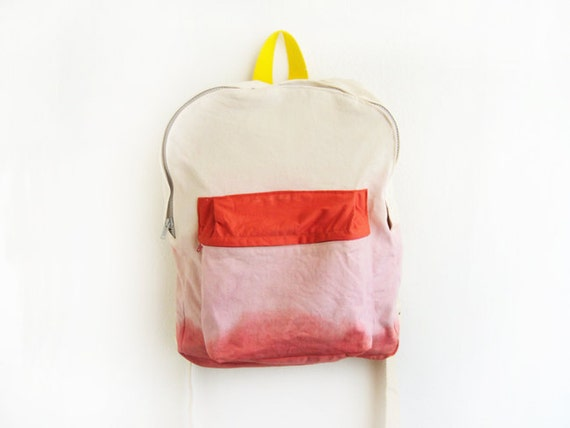 pink dyed backpack with orange pouch