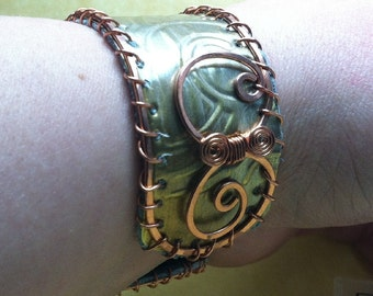 old bronze weatherstripping & copper cuff lined with teal rcycled leather