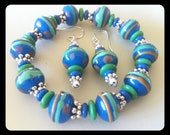 Turquoise teal and green beaded lampwork bracelet and matching earrings