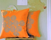 Orange Pillow with Astera Print
