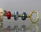 Vintage brass skeleton key with 3 spinning glass beads
