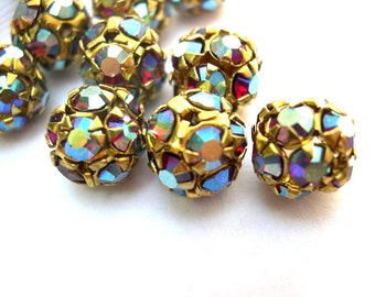 2 Vintage Swarovski crystal ball beads 10mm in brass metal setting