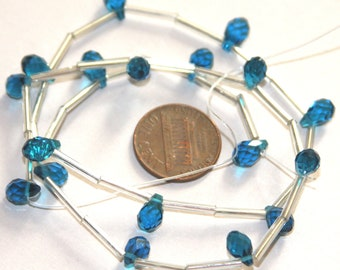 18 pcs of London blue quartz glass faceted briolette beads 5x7mm