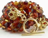 14k Gold and Crystal Bracelet in Red, Orange, Brown, Gold