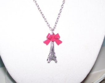Eiffel Tower Necklace with a Red Bow